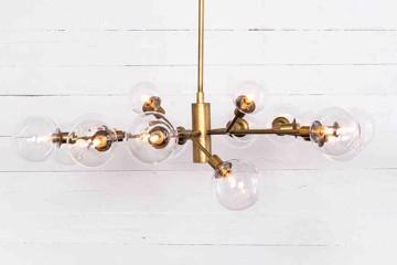 Four hands sunburst, glass bulb, bronze chandelier