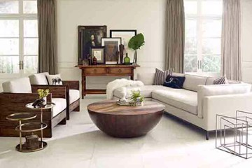 four hands cream sectional and wood accented armchairs