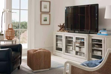 universal furniture media console with glass cabinets