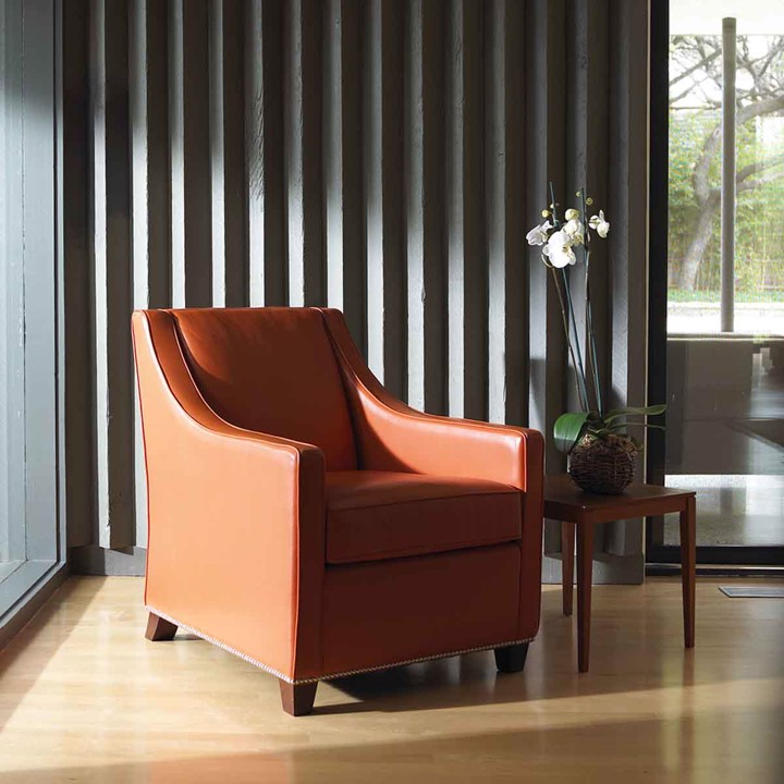 brown leather chair with side table