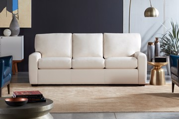 white leather sofa with side table