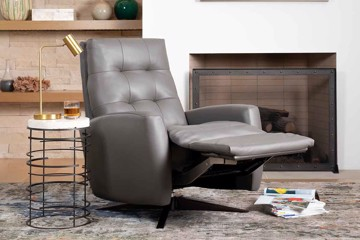 gray leather recliner with side table and lamp