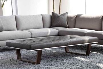 gray sectional with leather tufted ottoman