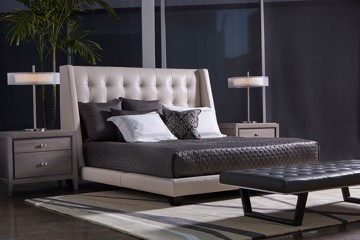 leather tufted bed with nightstands