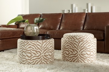 brown leather sofa with two ottomans