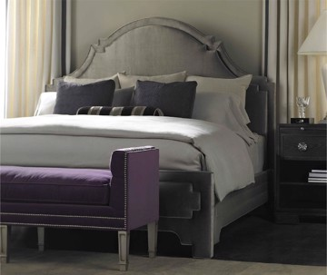 luxurious gray upholstered headboard and bed