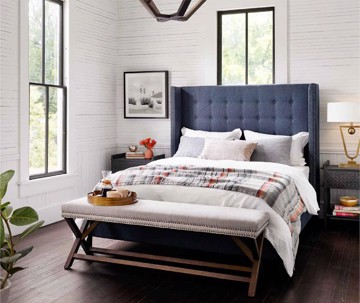 blue wingback bed with bench