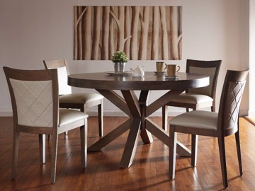 Wood X frame dining table with quilted upholstered dining chairs