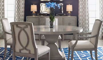 Grey wooden and upholstered dining chairs with pedestal table and grey buffet