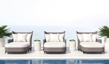 Grey woven deck chairs and ivory cushions