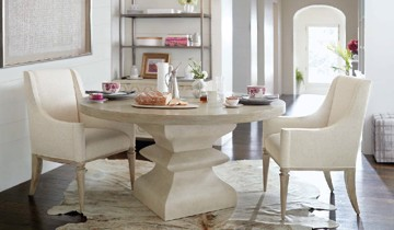 Ivory pedestal dining table with modern upholstered ivory dining arm chairs