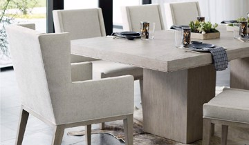 White linen upholstered dining chairs with wooden base
