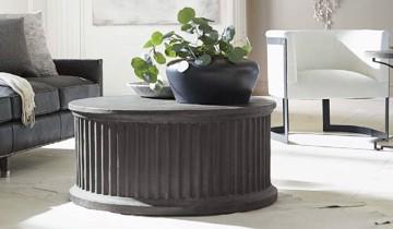 Grey round pedestal cocktail table