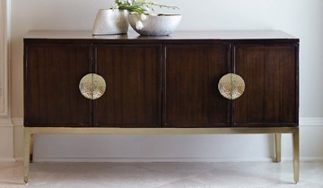 Dark wooden buffet with brass hardware and base