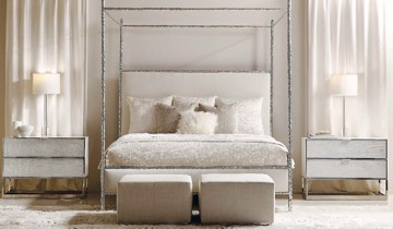 Metal four poster canopy bed with ottomans and two drawer nightstands
