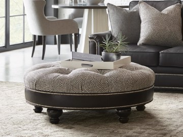 Round, tufted, upholstered and leather ottoman