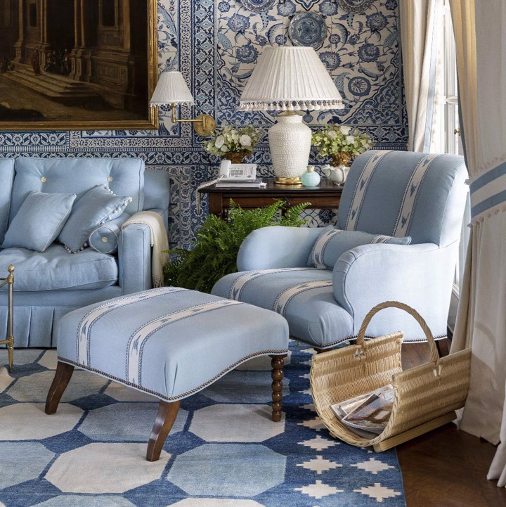 Light blue upholstered print arm chair with ottoman