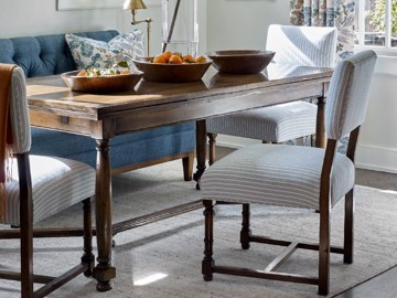 Wooden dining table with upholstered and wooden dining chairs
