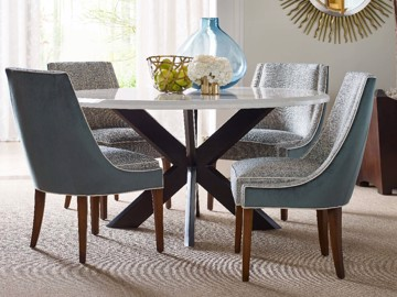 Blue and upholstered print dining chairs with x frame dining table