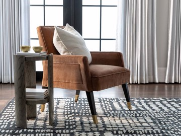 Brown upholstered arm chair with side table