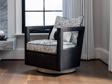 Modern dark wood arm chair with upholstered print cushion