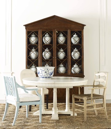 Collection of dining chairs with white dining table and wooden china hutch