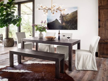 Dark wood farmhouse dining table and bench with slip-covered dining chairs