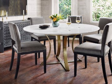 metal base dining table with grey upholstered dining chairs