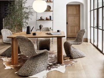 Woven dining chairs with wooden dining table