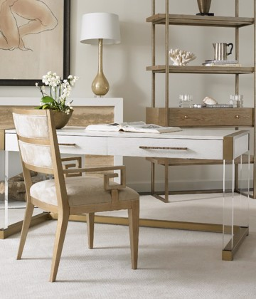 Gold and white modern desk with wood and upholstered chair