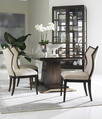 Dark wood and upholstered dining chairs with pedestal dining table