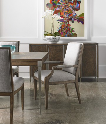 Medium wood and upholstered dining chairs with wood and metal dining table