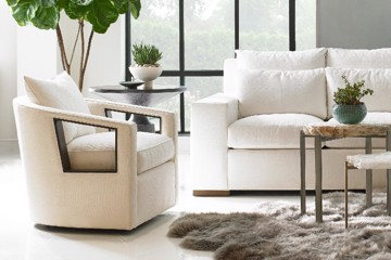 Beige custom upholstered arm chair with white upholstered sofa