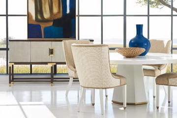 Custom two-tone upholstered dining chairs with buffet