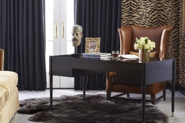 Dark wooden desk with tan leather chair