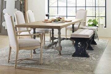 Wooden dining table with stretcher and upholstered dining chairs with upholstered bench
