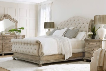 Ivory tufted upholstered sleigh bed