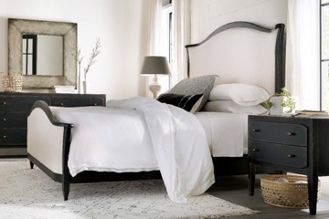 Black and white upholstered bed with black nightstand