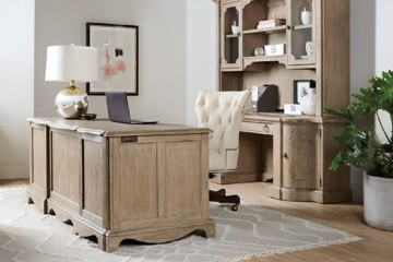 Natural wood finish desk with matching hutch and white upholstered desk chair