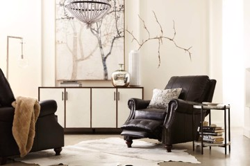 Dark leather motion recliner with nailhead trim