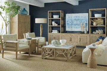 light wood upholstered chairs with square wooden cocktail table and large entertainment center