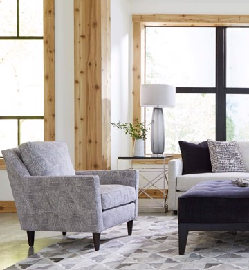 Upholstered print arm chair with upholstered sofa and metal end table