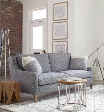 Upholstered print loveseat with wood end table and wood cocktail table with metal base