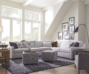 White upholstered sectional with upholstered square ottomans