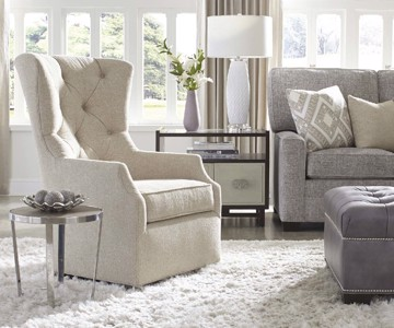Ivory tufted upholstered high back swivel arm chair with tufted leather ottoman