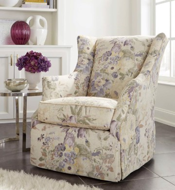 Upholstered floral print arm chair with metal and glass end table