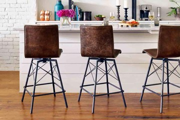 four hands bar stools with metal base and contemporary shape