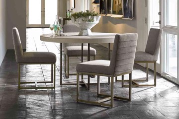 universal furniture round dining table and four upholstered dining chairs