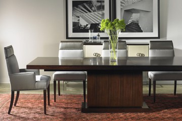 vanguard long dining table with pedestal base and upholstered dining chairs