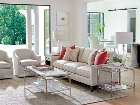Ivory upholstered sofa with upholstered chairs and glass and metal end table and cocktail table